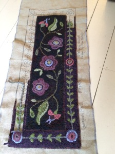 "Georgie's Floral Kit, wool and pattern on linen $225, 40"" long by 18"" wide."